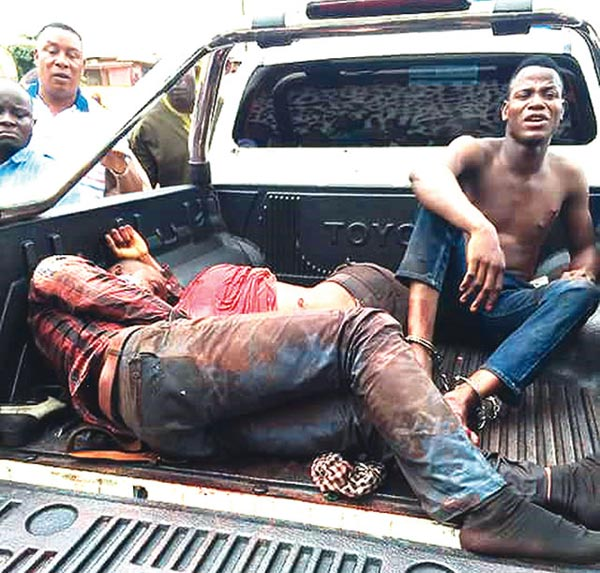 Graphic: Two robbers shot dead after attack on police inspector who withdrew cash from bank