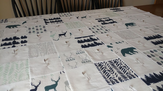 Little man woodland themed teal, navy, and gray baby quilt