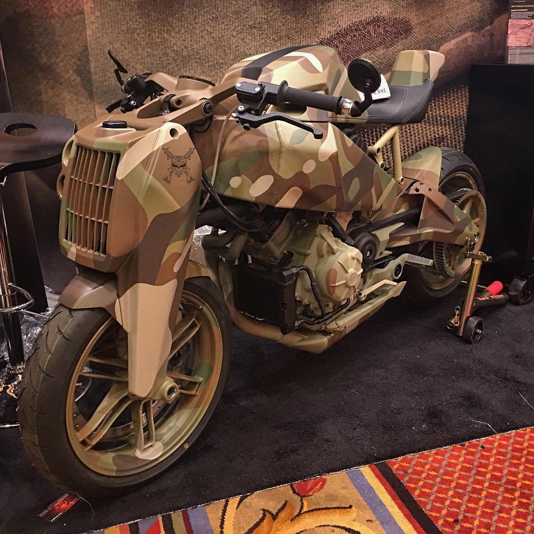 "Bike in the style of ""military"" at the Armory show Shot show 2016"