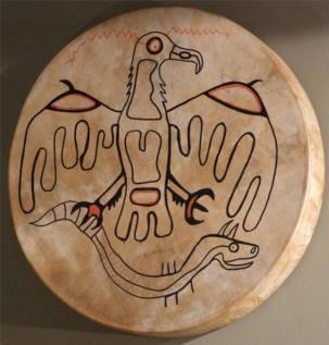 Miskwaabik Animikii painting on drum head of Thunderbird and the Great Horned Underwater Serpent