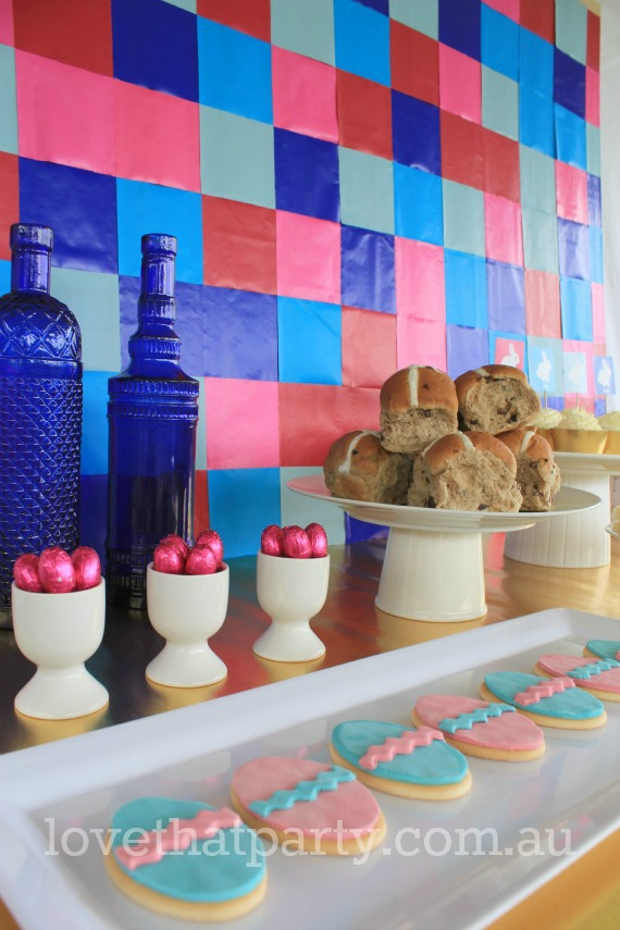 image of Easter party table with hot cross buns and Easter cookies