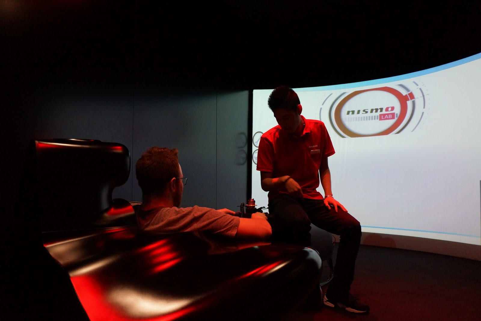 race car simulation at nissan innovation station at the o2
