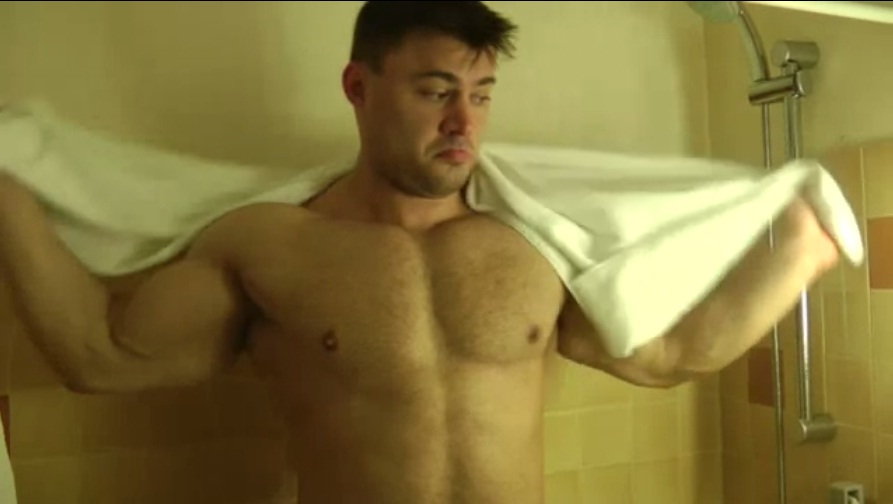 Muscled hunk in shower