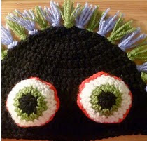 http://www.ravelry.com/patterns/library/mad-eye-hat