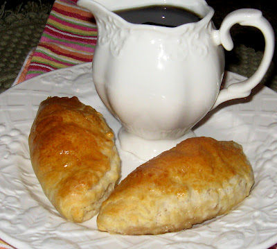 Maple Laced Sausage Filled Breakfast Pastries - I make several versions of these breakfast pastries, but, this maple laced sausage filled pastry is for those of you who enjoy maple syrup and sausage with your pancakes.  It's a simple preparation, and it's terrific for a make ahead morning meal or brunch.