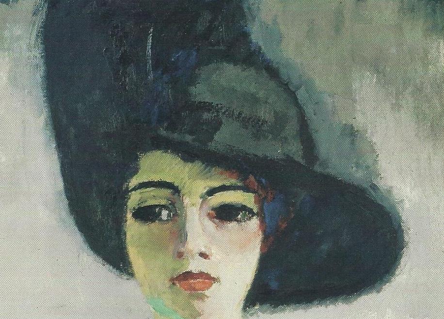 La mujer lleva un pañuelo de colores azules y rojos que compensan el tono  excesivamente oscuro del sombrero. 00576b5c71c