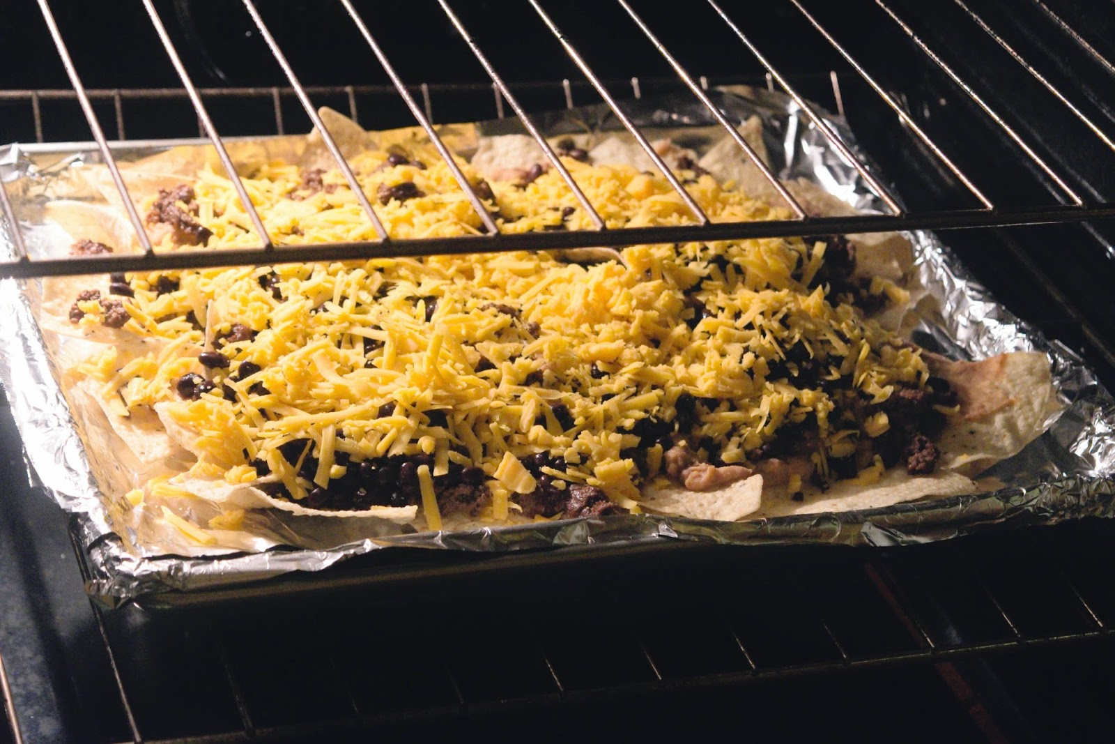 The Nachos Supreme being put in the oven to bake.