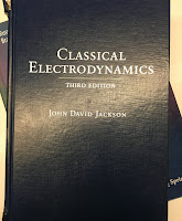 Classical Electrodynamics, 3rd Ed, by John David Jackson, superimposed on Intermediate Physics for Medicine and Biology.