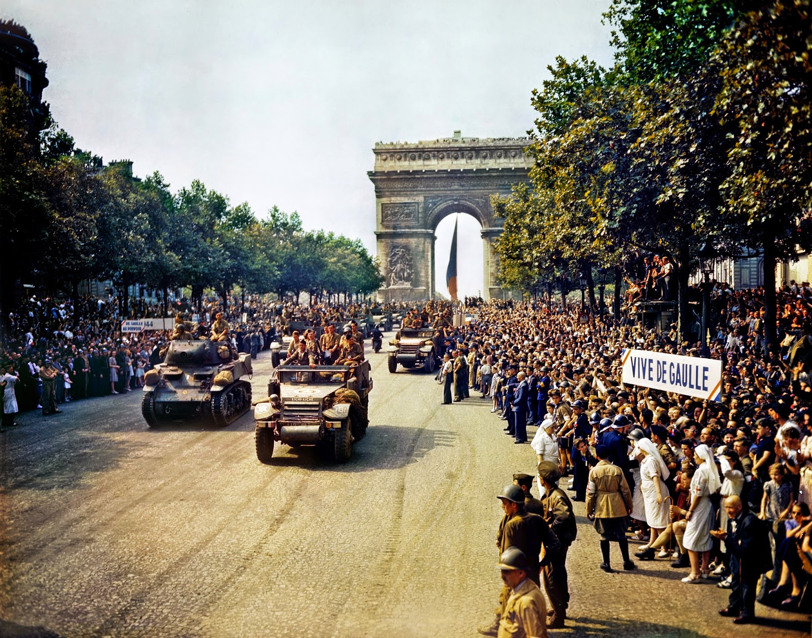 Free French tanks and half tracks of General Leclerc's 2nd Armored Division passes through the Arc du Triomphe