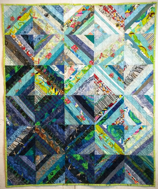 Paper pieced string quilt in all shades of blue