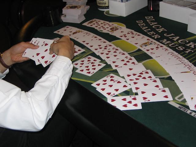 Casino-Dealer-Sorts-Card-Decks