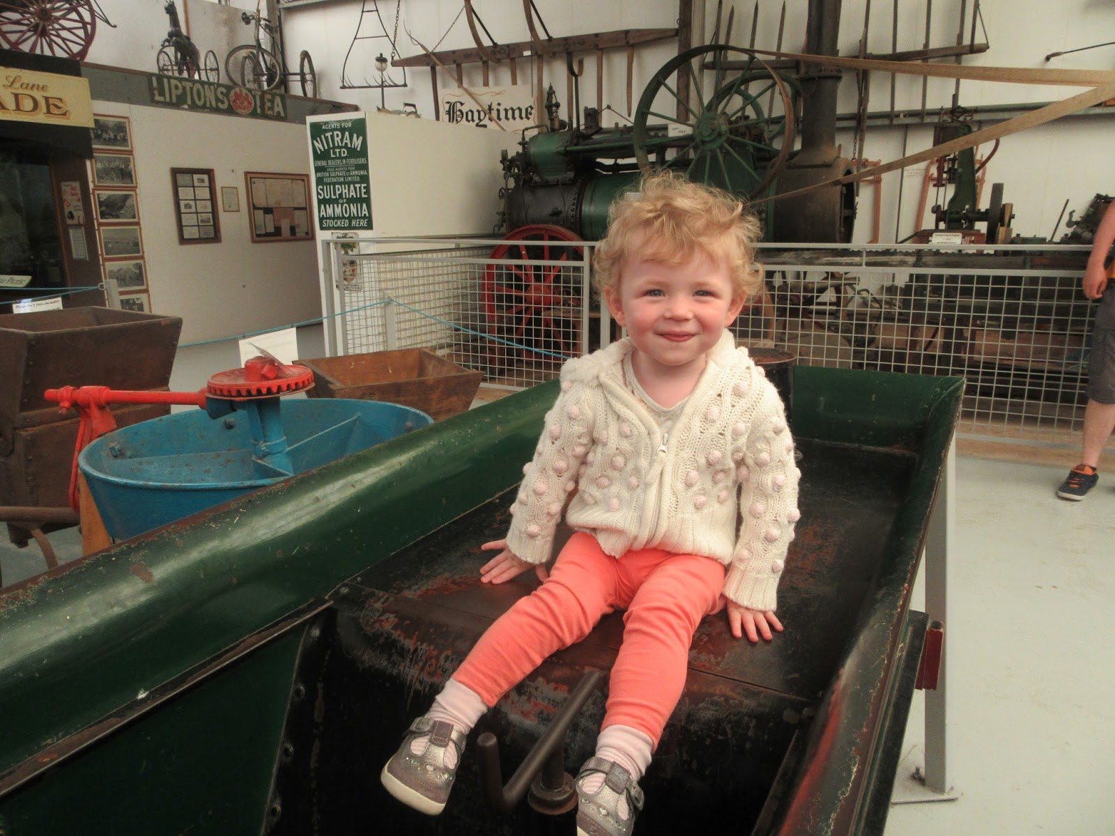 Annabelle playing on a miniature steam engine