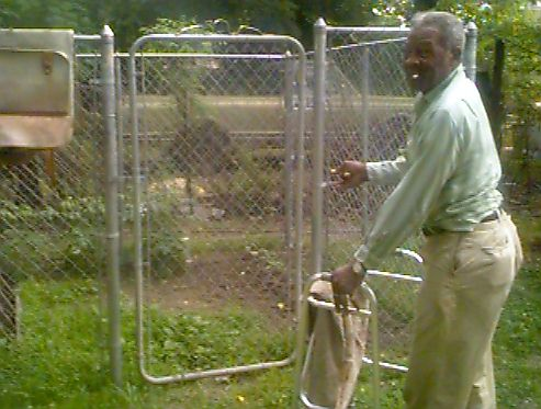 Willie at the gate to his garden.