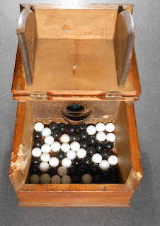 "Image of Fraternity ""Balckball"" box: voting side"