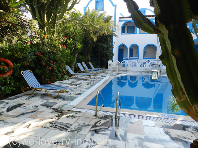 The pool and lounge chairs await the guests