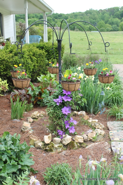 Turn old farm equipment into a way to hang your flowering baskets this summer!  A great project for any yard.  Plus enter to win a $25 gift card!