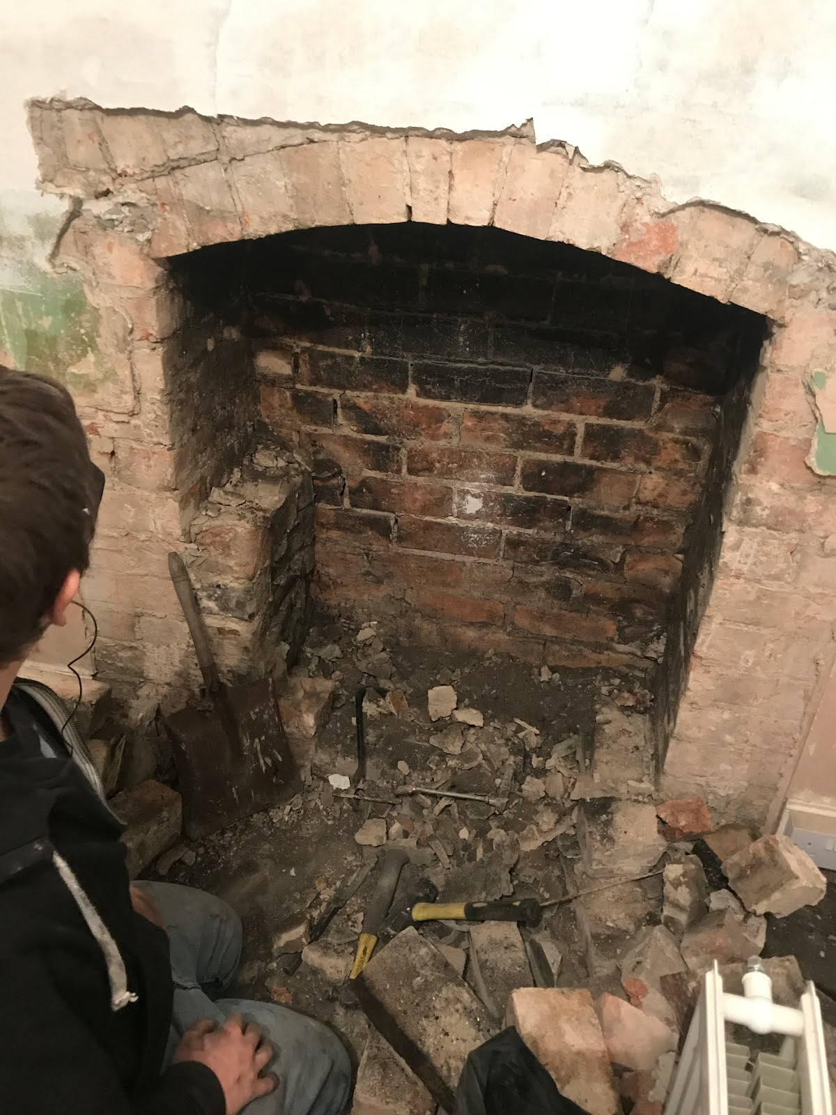 victorian chimney with hidden arch behind plaster