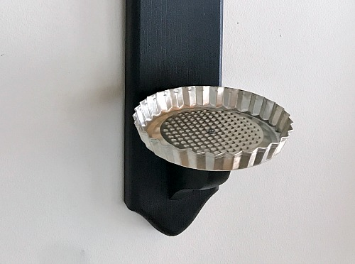 metal tart pan attached to candlestick