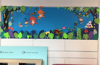 Hand-made display and recycling bins in children's area