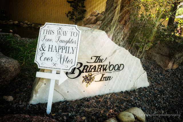 The entrance sign to The Briarwood Inn in Golden Colorado for a wedding