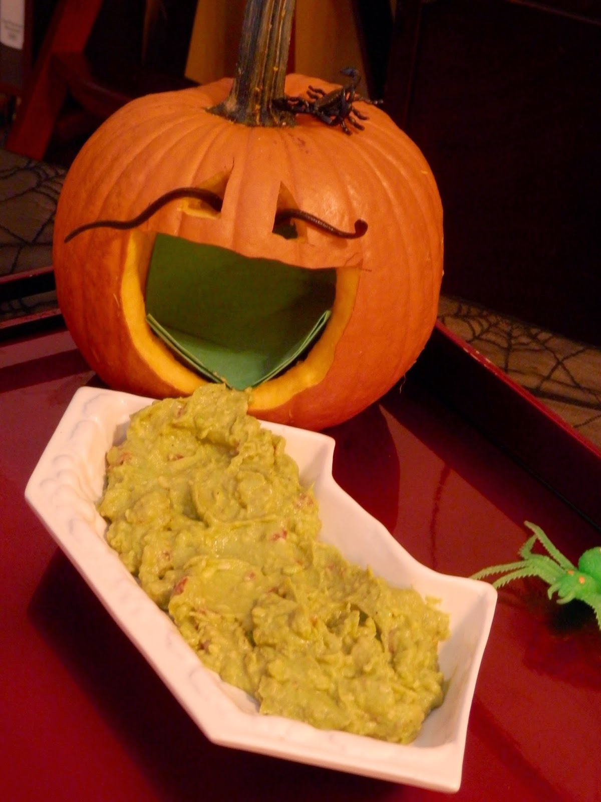 Halloween pumpkin throwing up guacamole