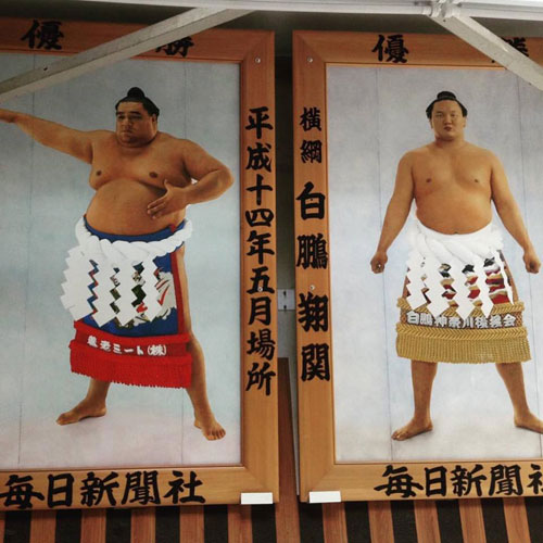 Paintings of sumo wrestlers in Ryogoku Station.