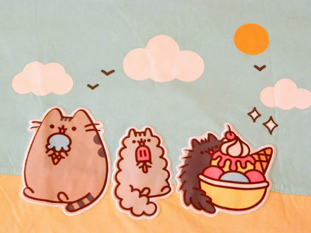 A vest top/tank top featuring Pusheen the cat characters at the beach
