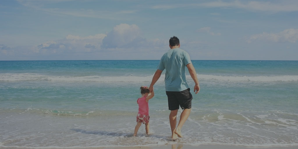 Father and daughter spending time together on the beach