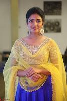 Actress Eesha in Yellow Choli Blue Ghagra at Darshakudu music launch 029.JPG