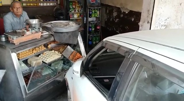 A speeding car rammed into a sweet shop in Ballgagadh, two injured, policeman's car