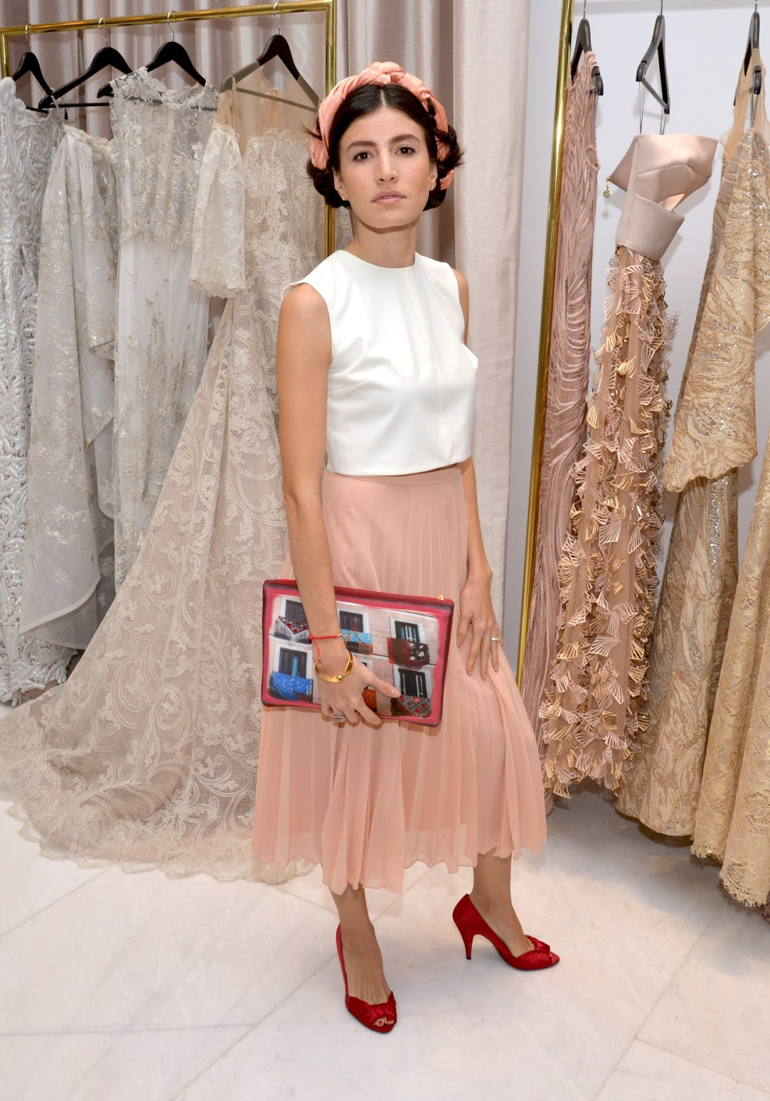 Danie Gomez Ortigoza dons a Silvia Tcherassi clutch at Miami atelier