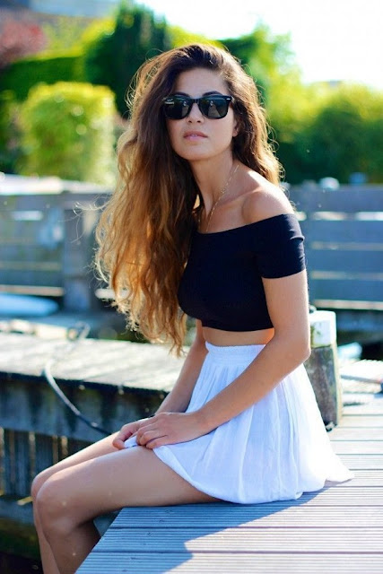 off shoulder top with a mini skirt