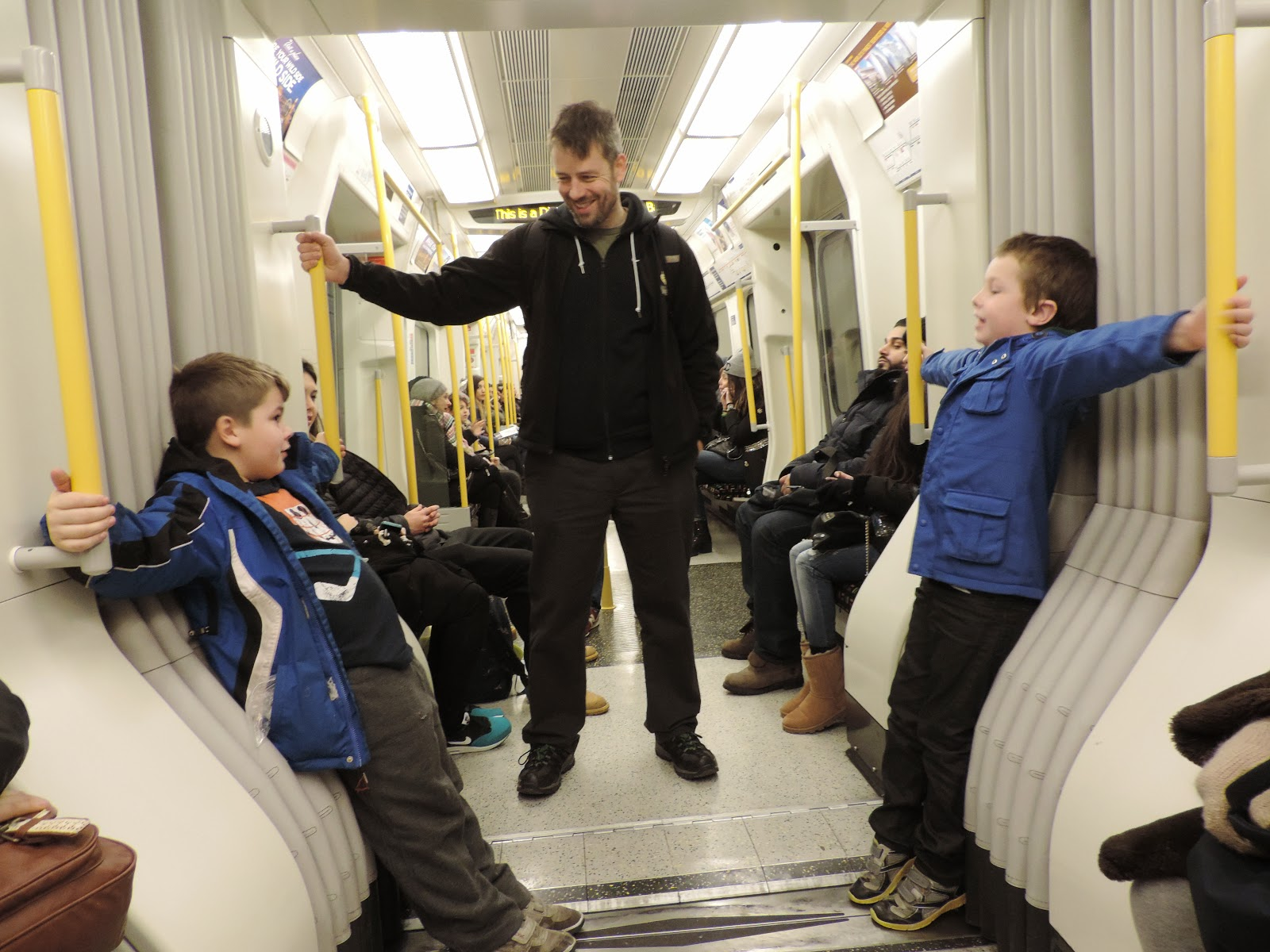 boys having fun on london transit system