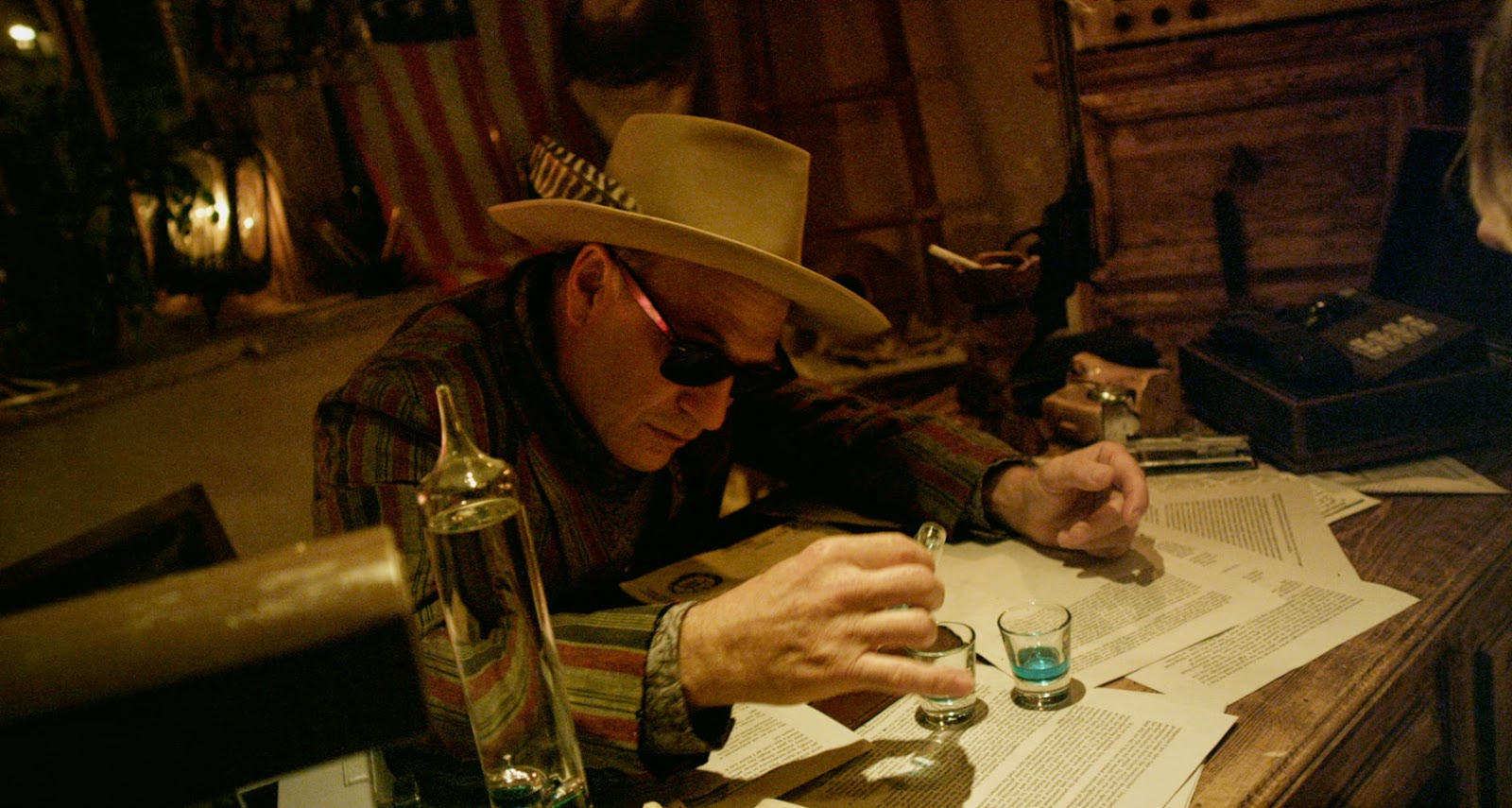 Ted Levine pours some of the magical liquid that will allow them to see us.