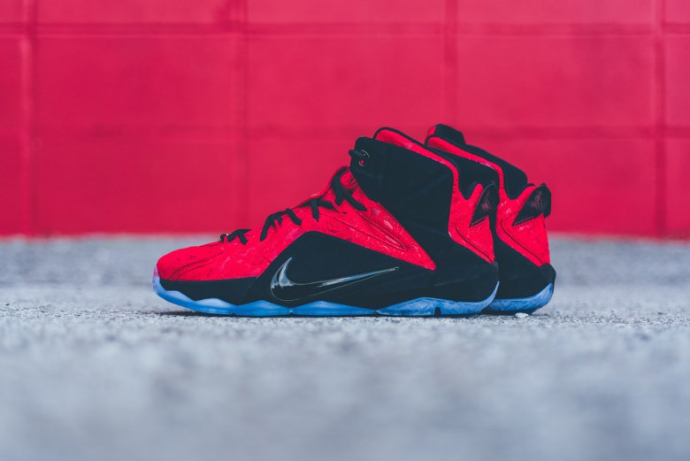 """quality design 3a492 dcd4b The LeBron 12 EXT """"Red Paisley"""" comes outfitted with a relieved upper,  meticulously detailed with floral motifs throughout the red suede paneling."""