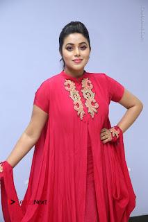Actress Poorna Latest Stills in Red Dress at Rakshasi First Look Launch  0168.JPG