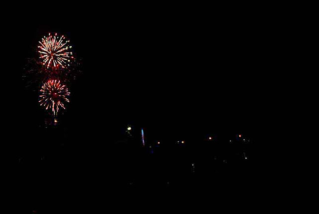 Illuminations exploding over fairgrounds