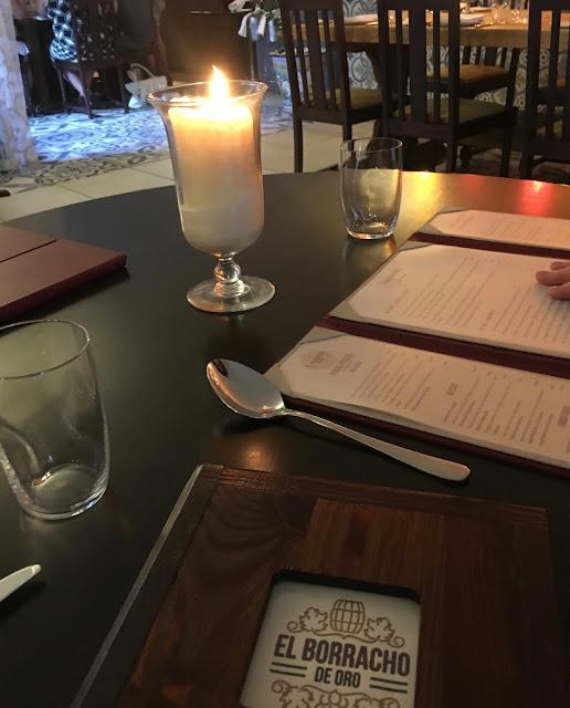 Candle and menu at El Borracho Del Oro in birmingham