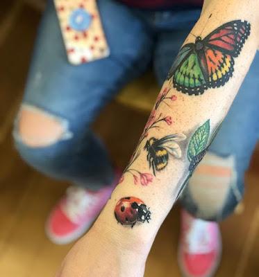girl arm ladybug tattoo