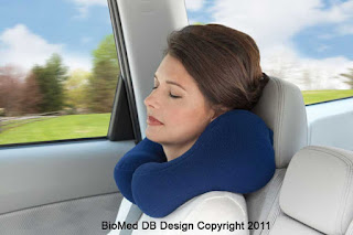 woman sleeping with a biomed design travel pillow