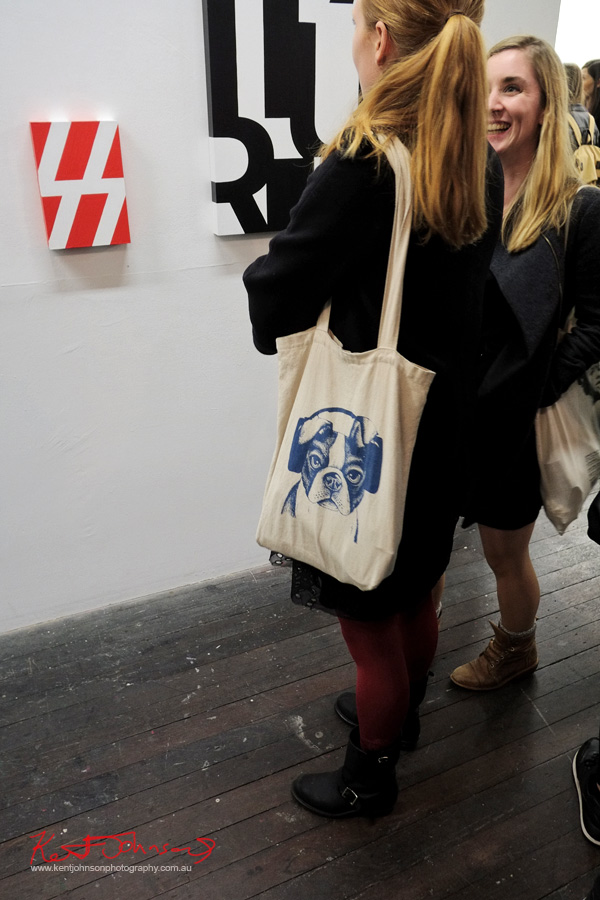 Calico bag, Dog in headphones print, Street Fashion - China Heights Gallery. Photo by Kent Johnson.