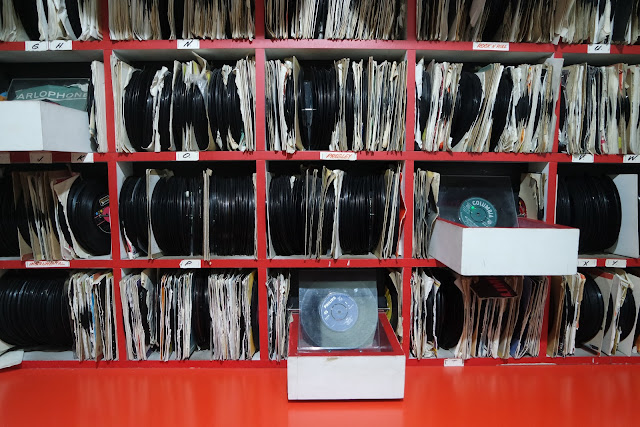 thousands of records stacked in red shelves