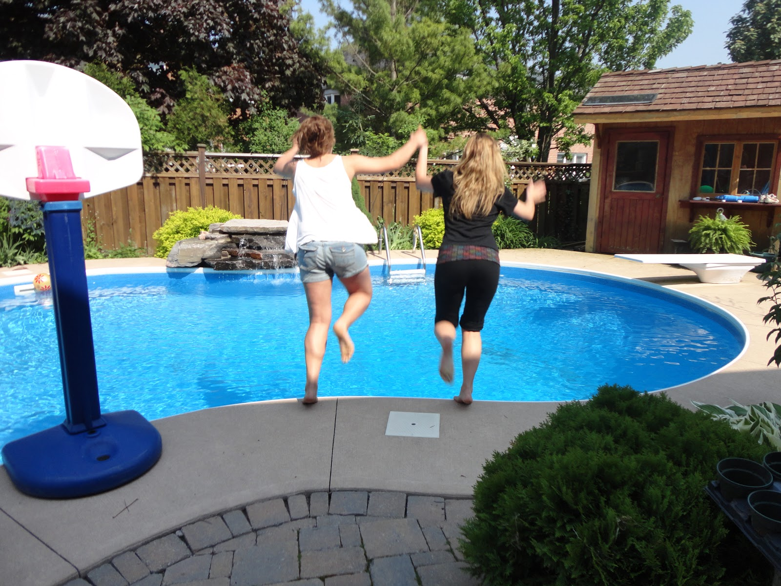 3ccaa2fb30 When I got home I ran to the backyard where my sister was reading and I  convinced her to jump in the pool with me... FULLY DRESSED!