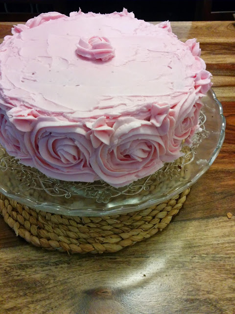 pink cake with buttercream roses