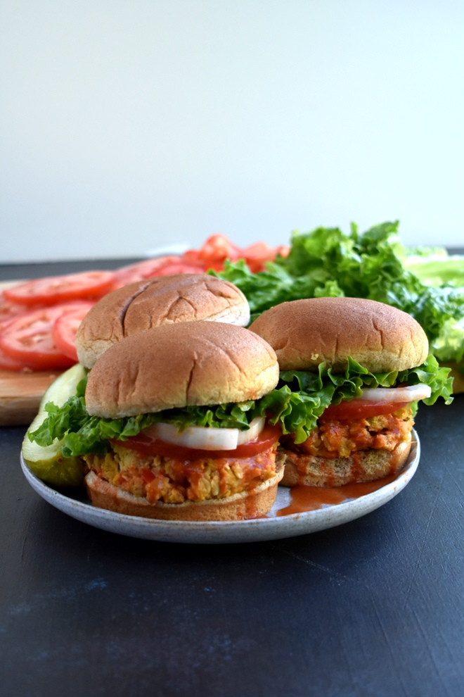 Buffalo Chickpea Burgers are loaded with sauteed veggies, chickpeas and spicy buffalo flavor for a healthy but hearty meal! www.nutritionistreviews.com