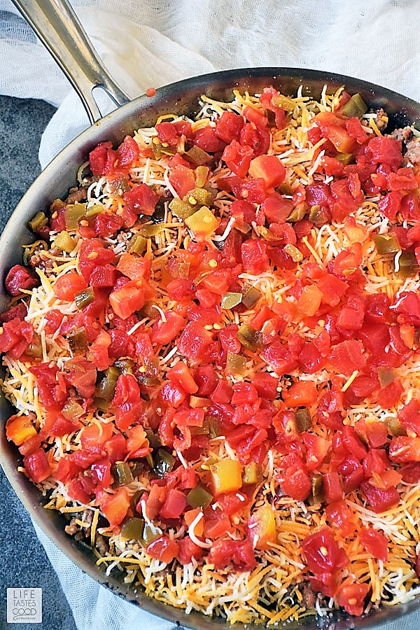 All Hot Mexican Dip Skillet Recipe ingredients layered into skillet and ready to bake