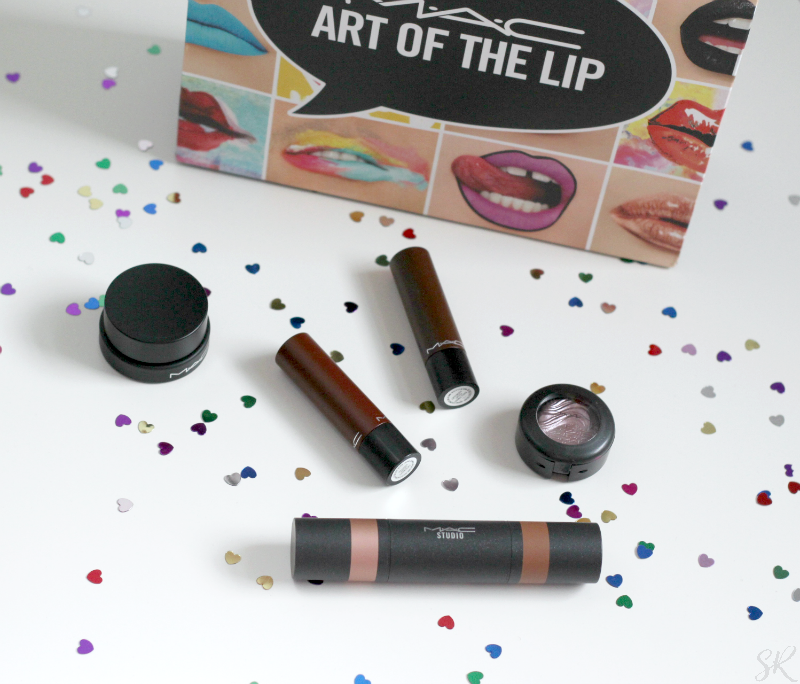 a picture of a MAC shopping bag with lipsticks on a table