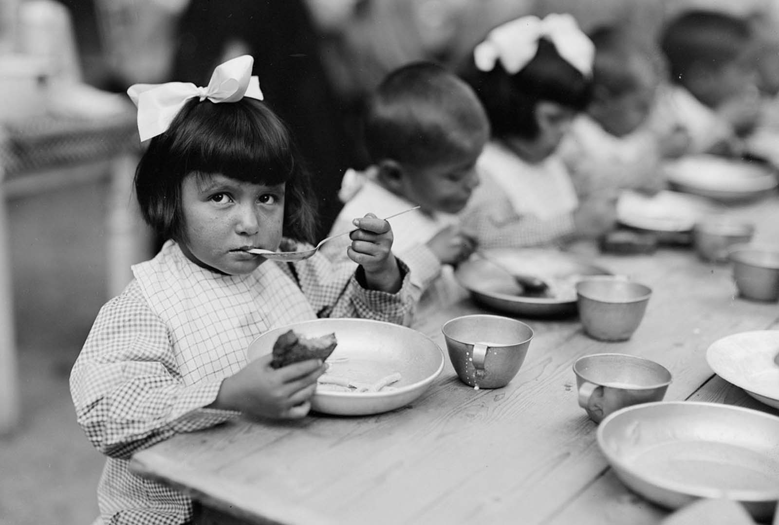 Meal time at La Jonchere, one of the colonies established by the Comite Franco-Americain pour la Protection des Enfants de la Frontiere, which, with aid from the American Red Cross, provides a home and education for about 1,500 children made destitute by the war. July, 1918.