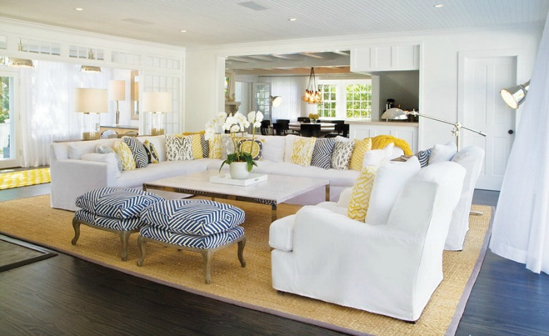 White slipcover sectional sofa and chairs in beautiful coastal beach house