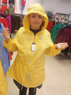 Top Ender trying on a Raincoat in Primark